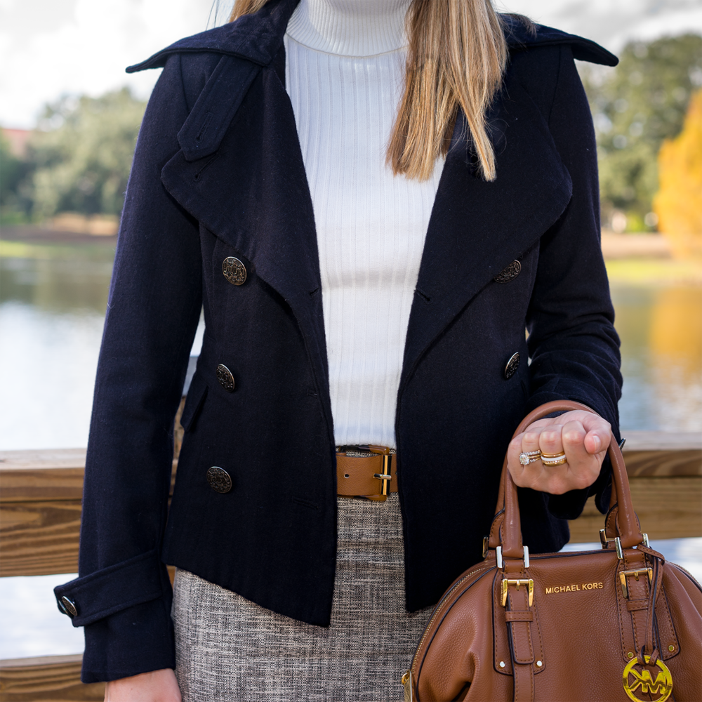 Navy coat, ivory turtleneck, tweed skirt