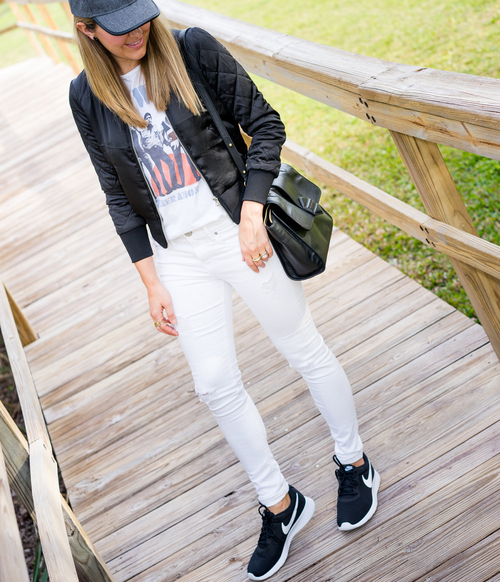 Baseball hat, graphic tee, bomber jacket, white jeans