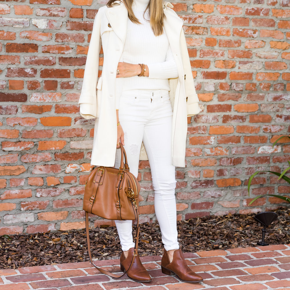 Ivory coat, sweater, and jeans