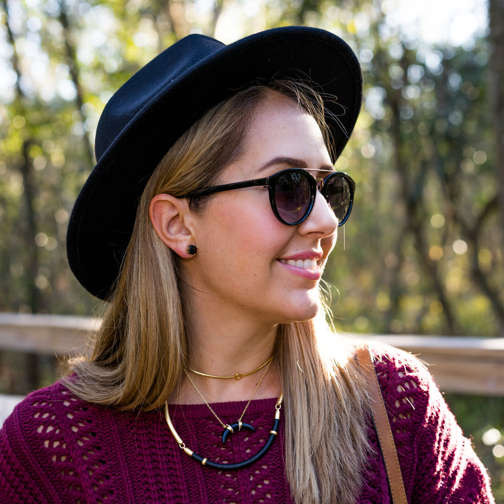 Black fedora, burgundy sweater