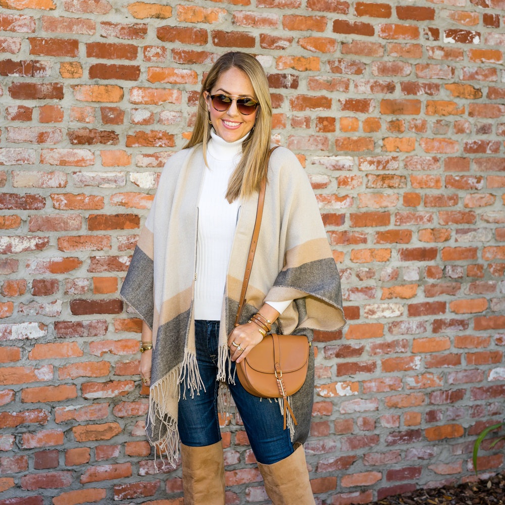 Poncho, ivory turtleneck, over the knee boots
