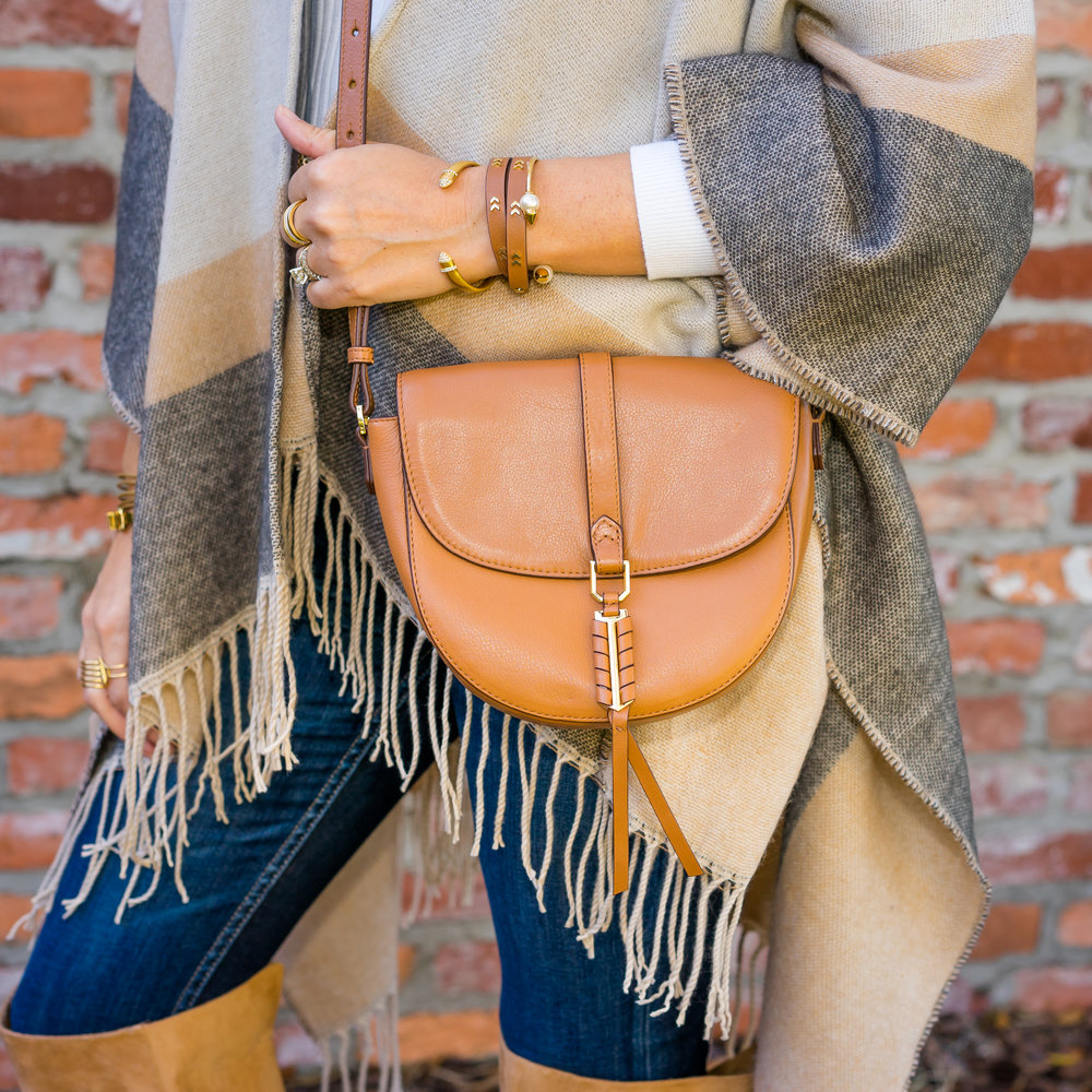 Poncho, ivory turtleneck, Covet purse