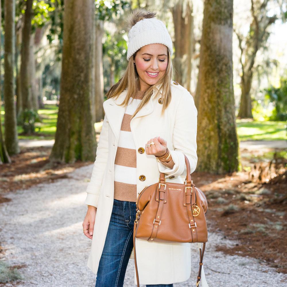 Ivory coat, beige stripe sweater, beanie
