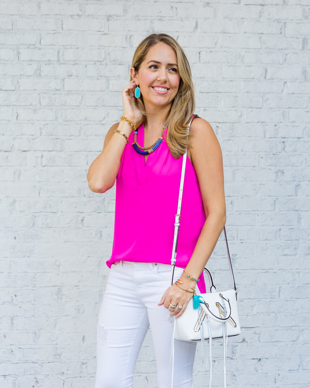 Hot pink top, white jeans, Kendra Scott earrings