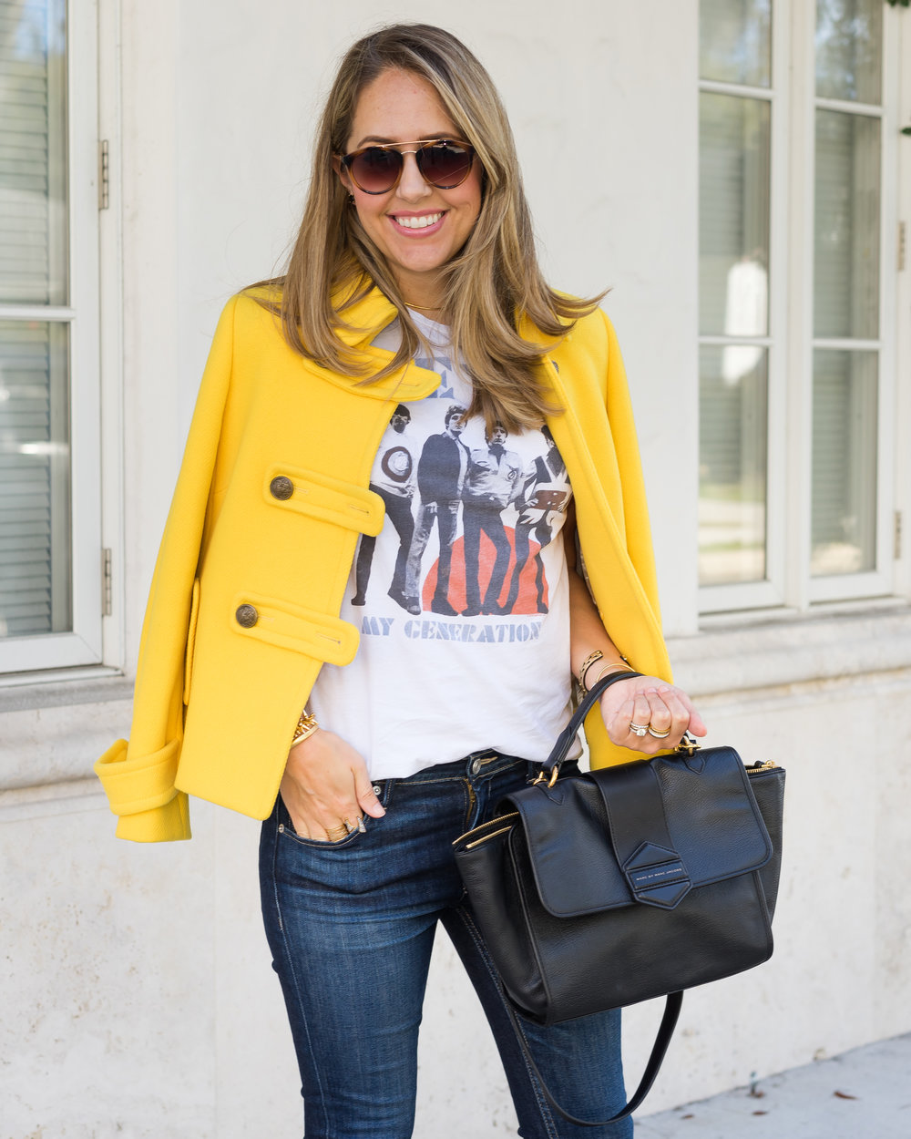 Yellow coat, concert tee, Marc Jacobs purse
