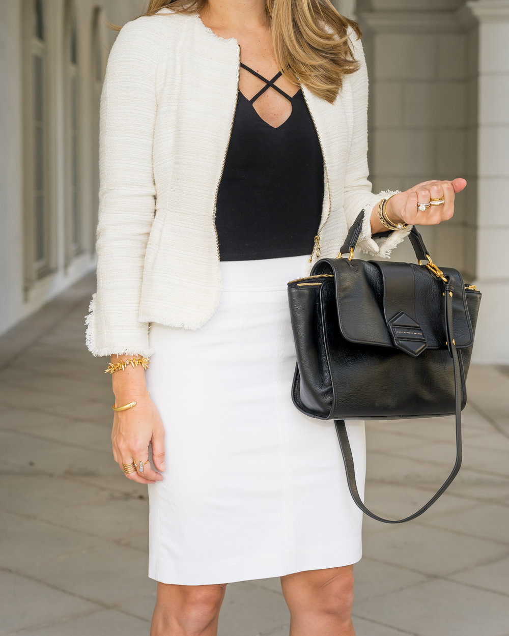 White boucle suit with black criss cross top