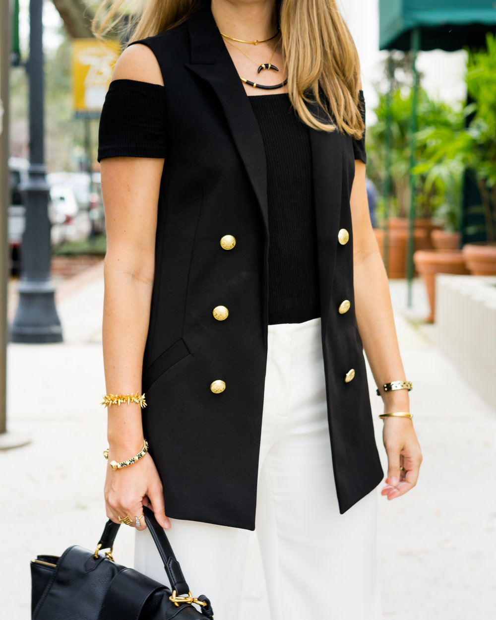 Long black vest, cropped ivory pants