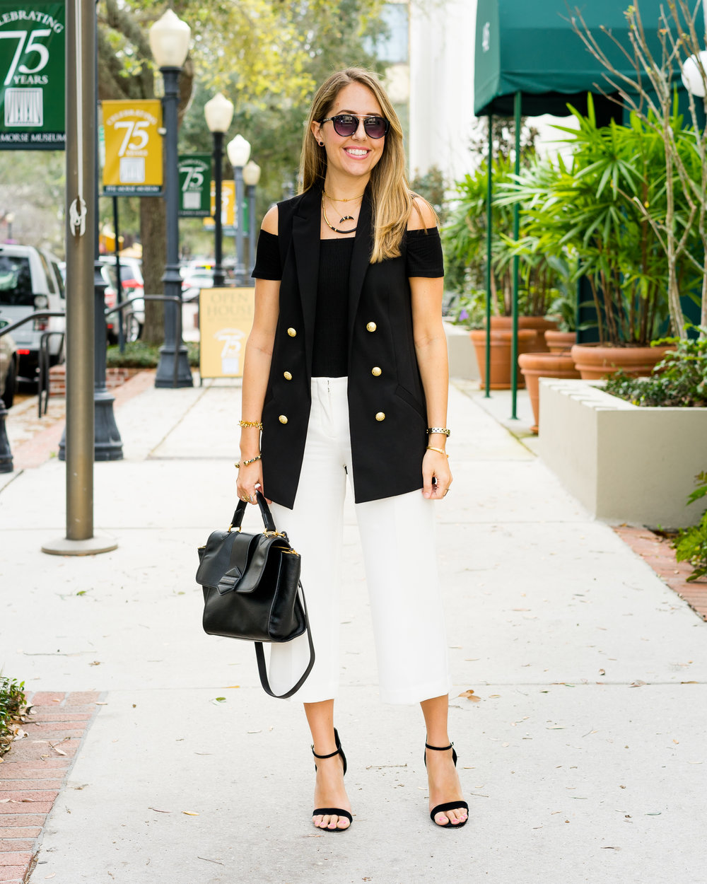 Long black vest, cropped ivory pants, ankle strap heels