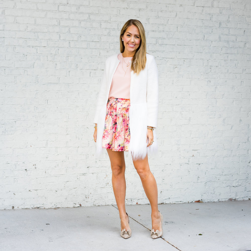 Faux fur trim coat, blush top, floral skirt, bow pumps