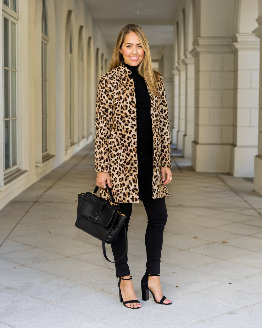 Leopard coat, black turtleneck, black heels