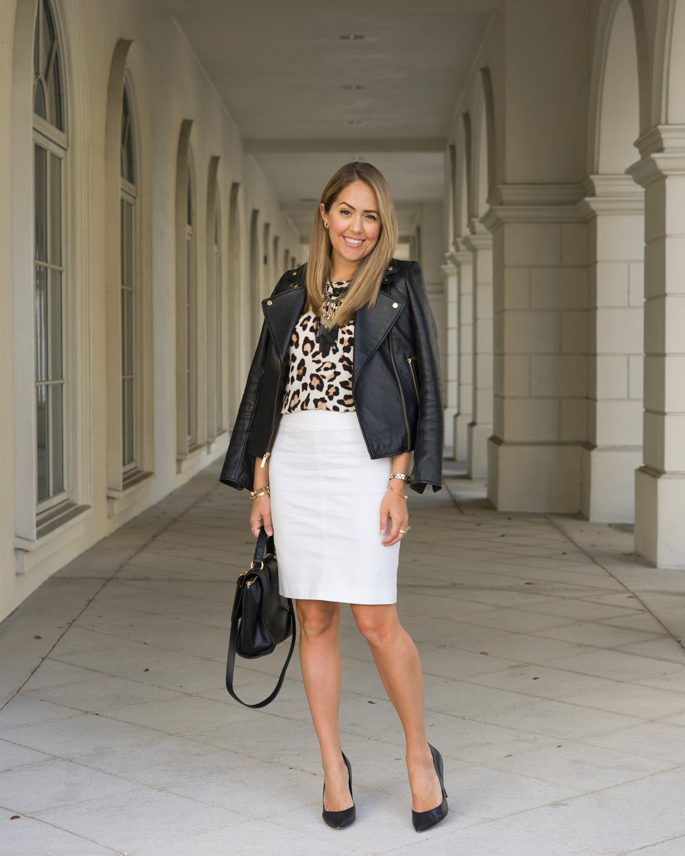 Black leather jacket, leopard top, white skirt