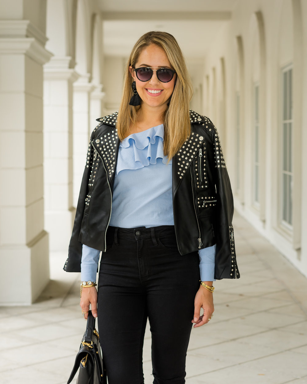 Studded leather jacket, blue ruffle top