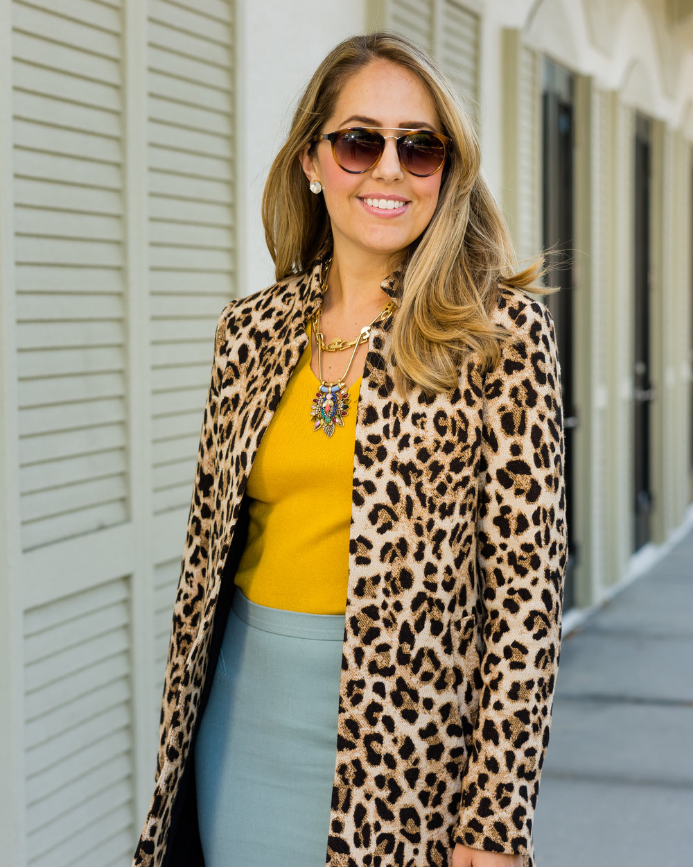 Leopard coat, mustard sweater, mint skirt