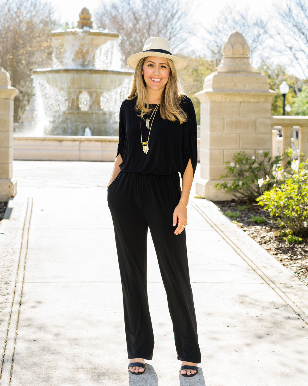 Panama hat, black jumpsuit