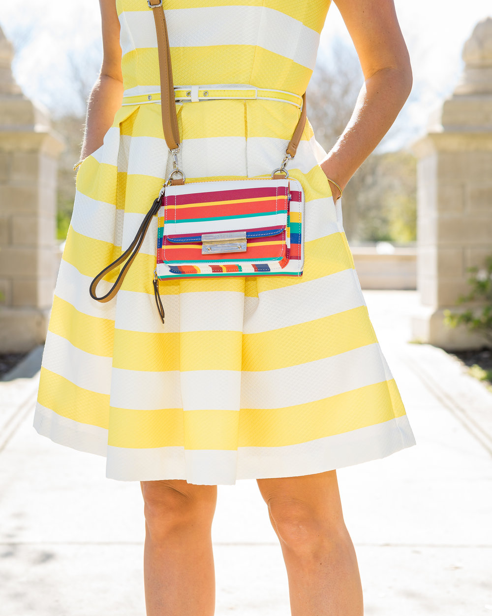 Yellow stripe dress and rainbow stripe purse