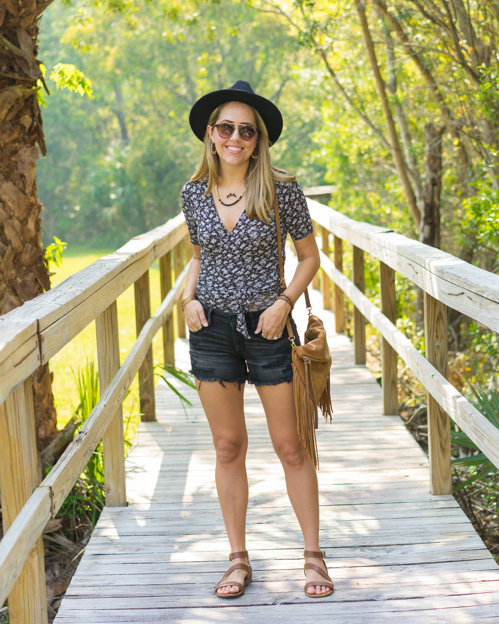 boho for summer: wrap top, denim shorts, fringe purse
