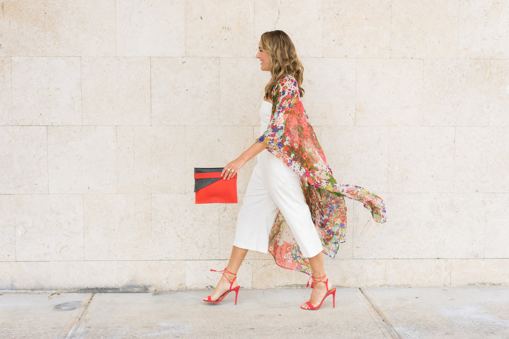 Kimono cardigan, white jumpsuit, red heels, Deux Mains fair trade clutch