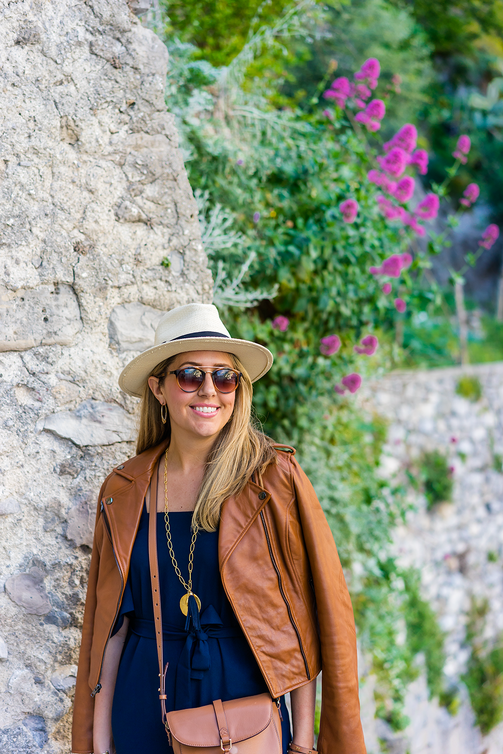 Positano, Italy - leather jacket, panama hat, navy jumpsuit