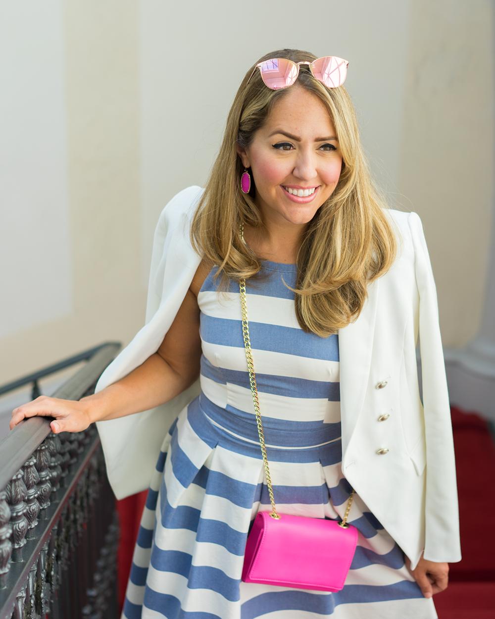 White blazer, blue stripe dress, pink purse