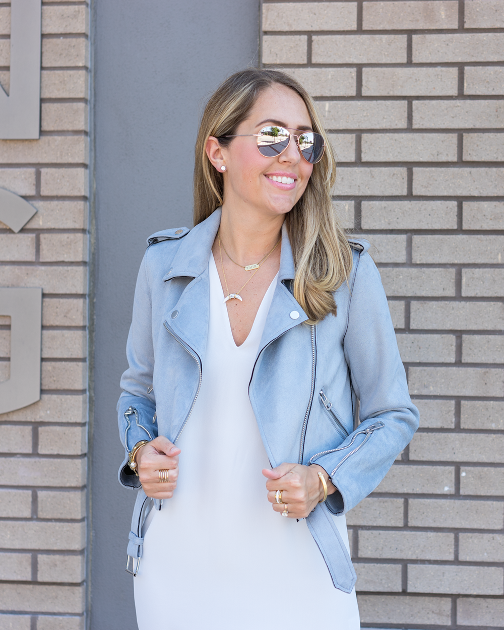 Gray moto jacket, white silk dress