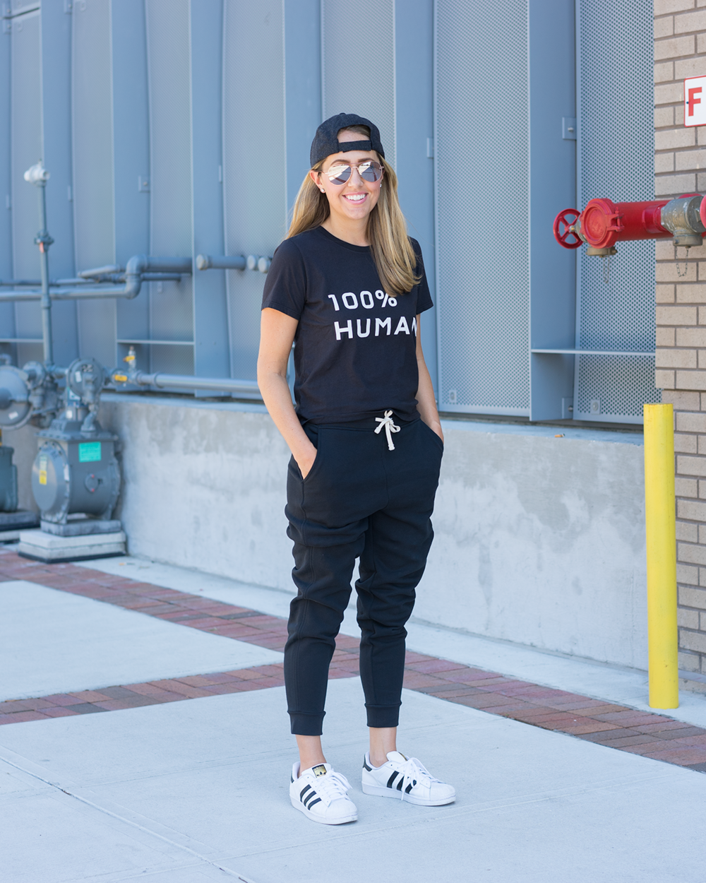 Black graphic tee, black sweats from Everlane