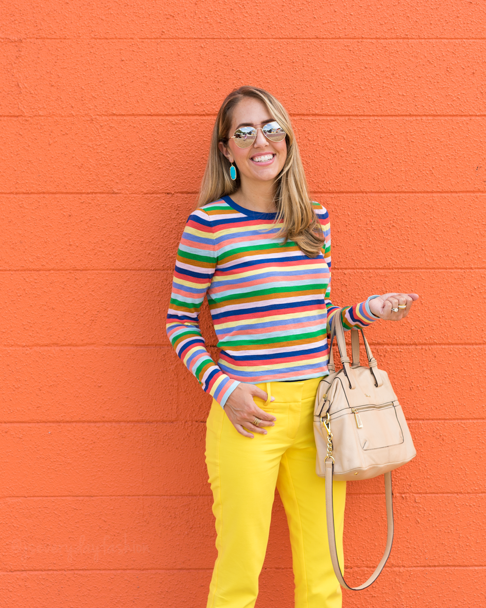 Rainbow stripe sweater, yellow pants