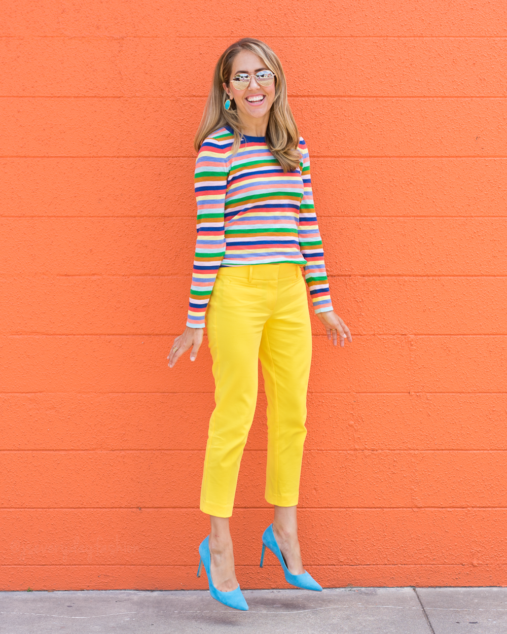 Rainbow stripe sweater, yellow pants, blue heels