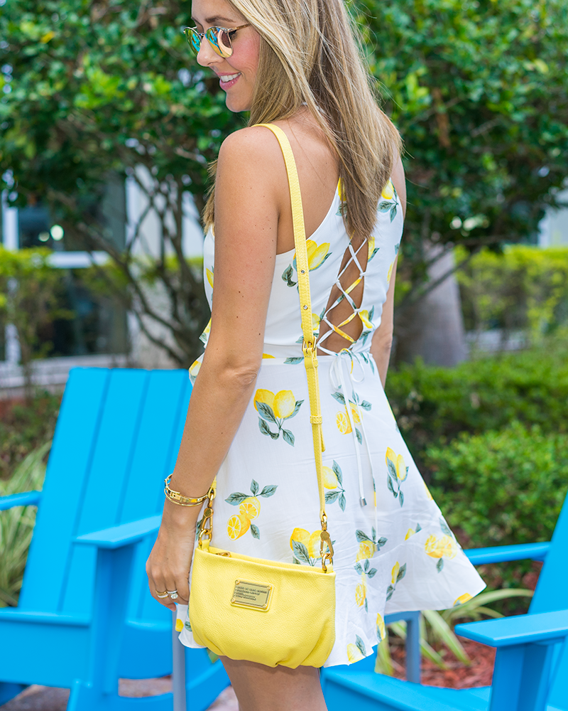 Lemon print dress, yellow purse
