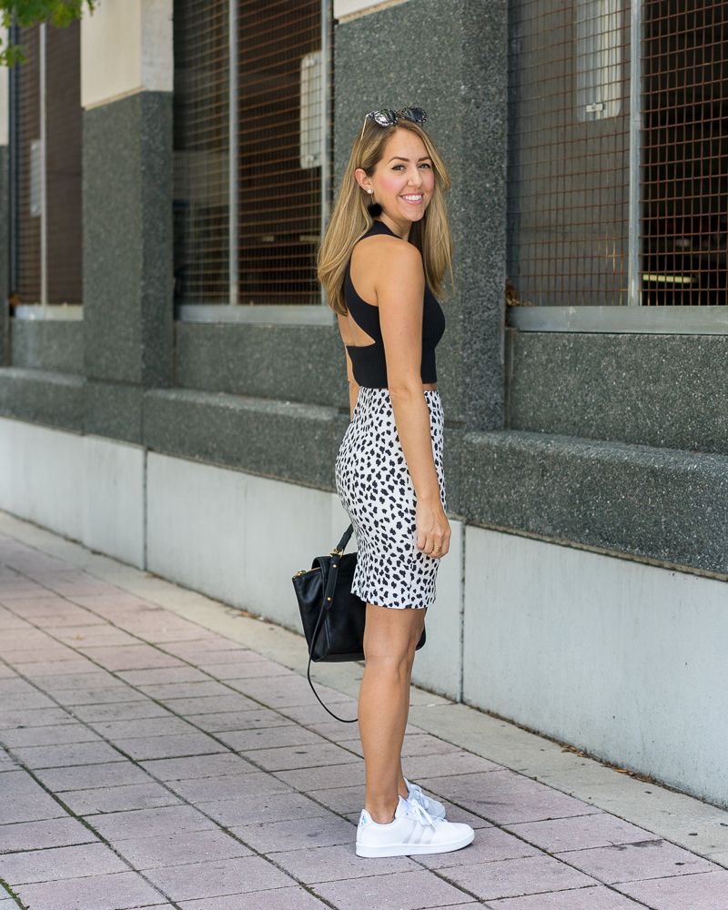 Black crop top, dalmatian print skirt, white Adidas sneakers