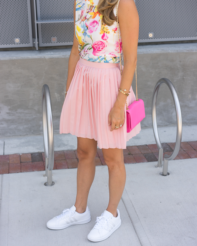 Floral top, pink pleated skirt, Adidas sneakers