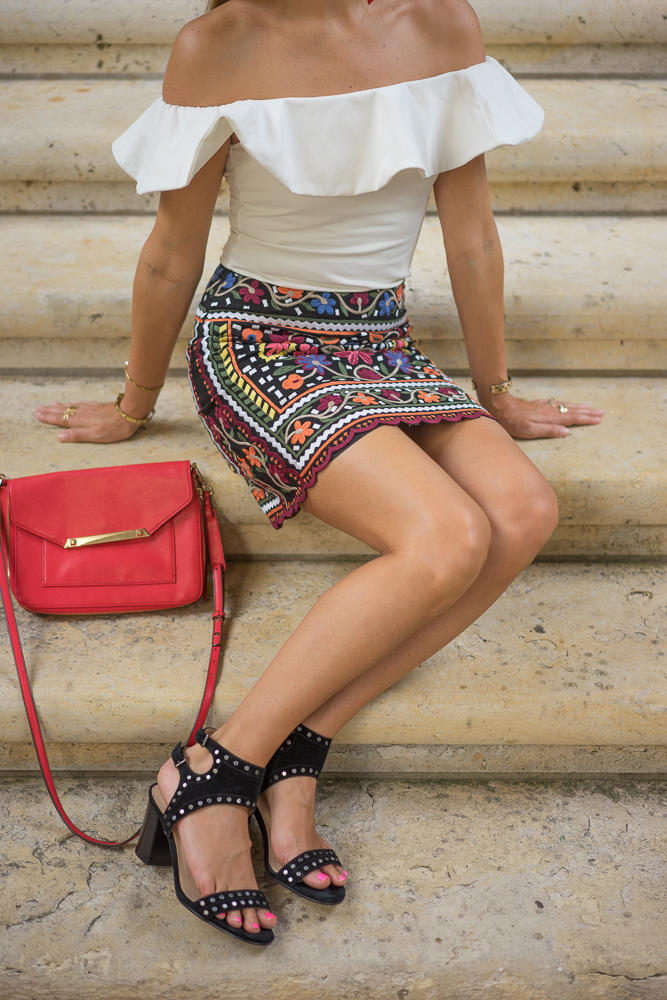 Embroidered skirt, white ruffle top, studded black shoes