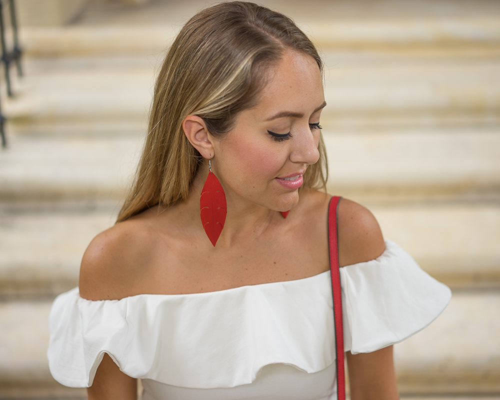Red Deux Mains earrings, white ruffle top