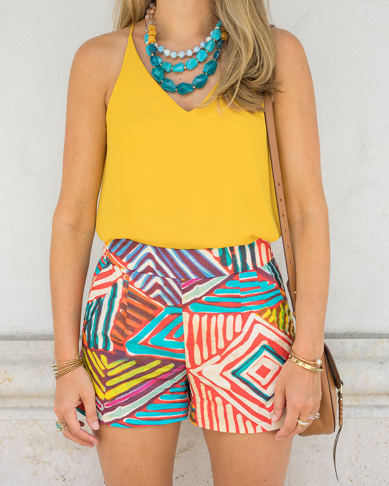 Yellow top, printed shorts, turquoise necklace
