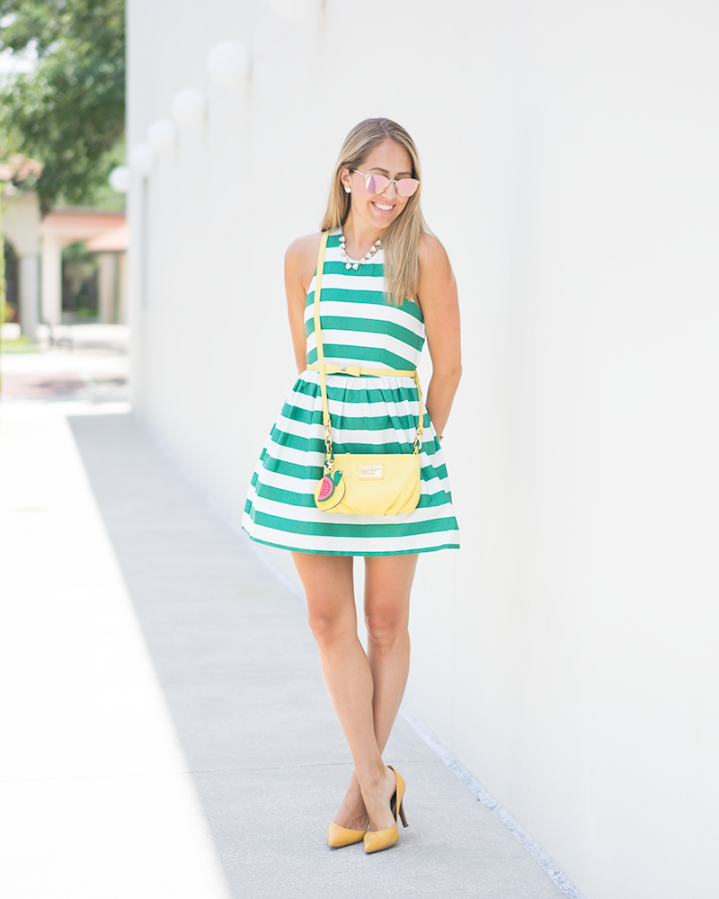 Green stripe dress, yellow purse, bow belt