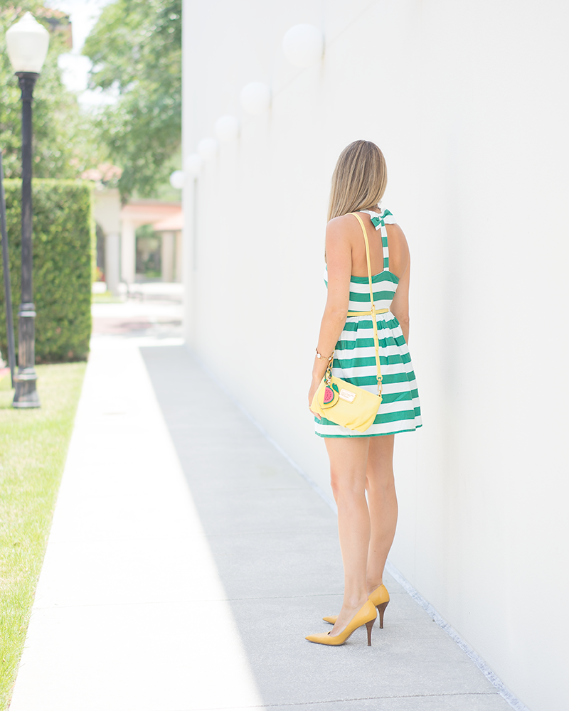 Green stripe dress, bow belt, yellow purse