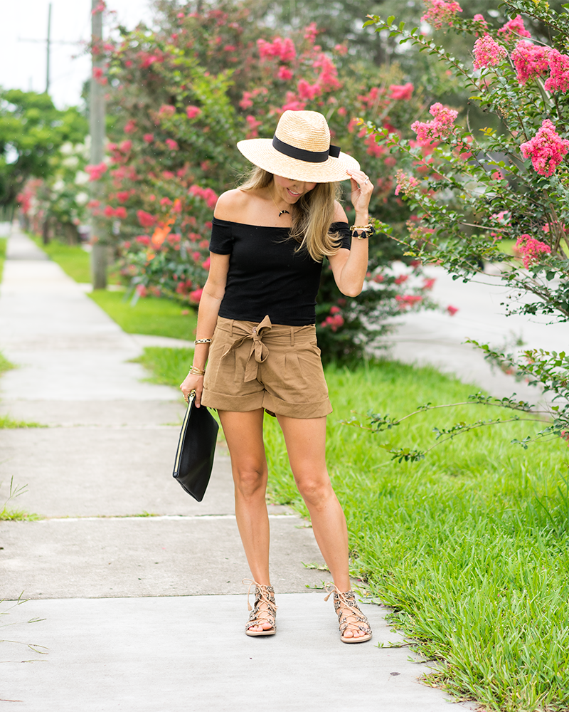 Black off shoulder crop top, tie waist shorts, panama hat