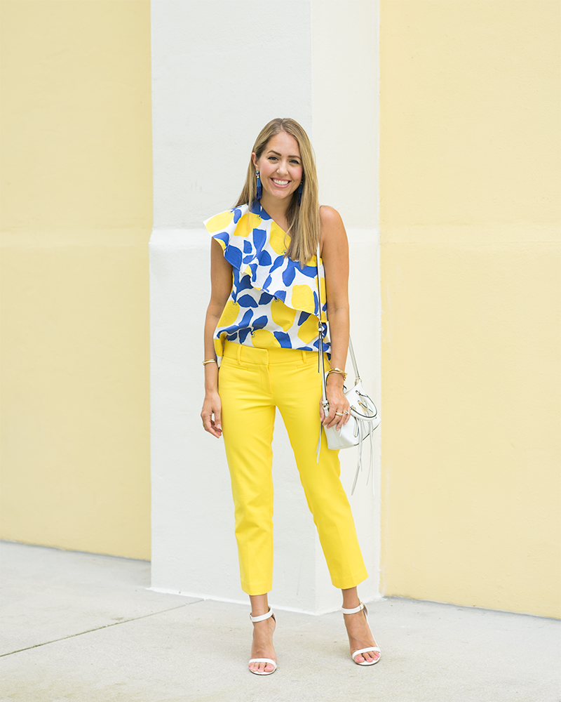 LOFT one shoulder lemon print top, yellow pants, blue tassel earrings