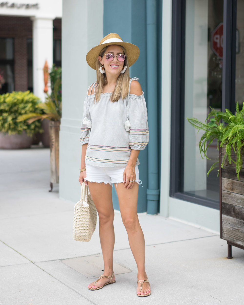 Off shoulder top, white shorts, straw hat and bag