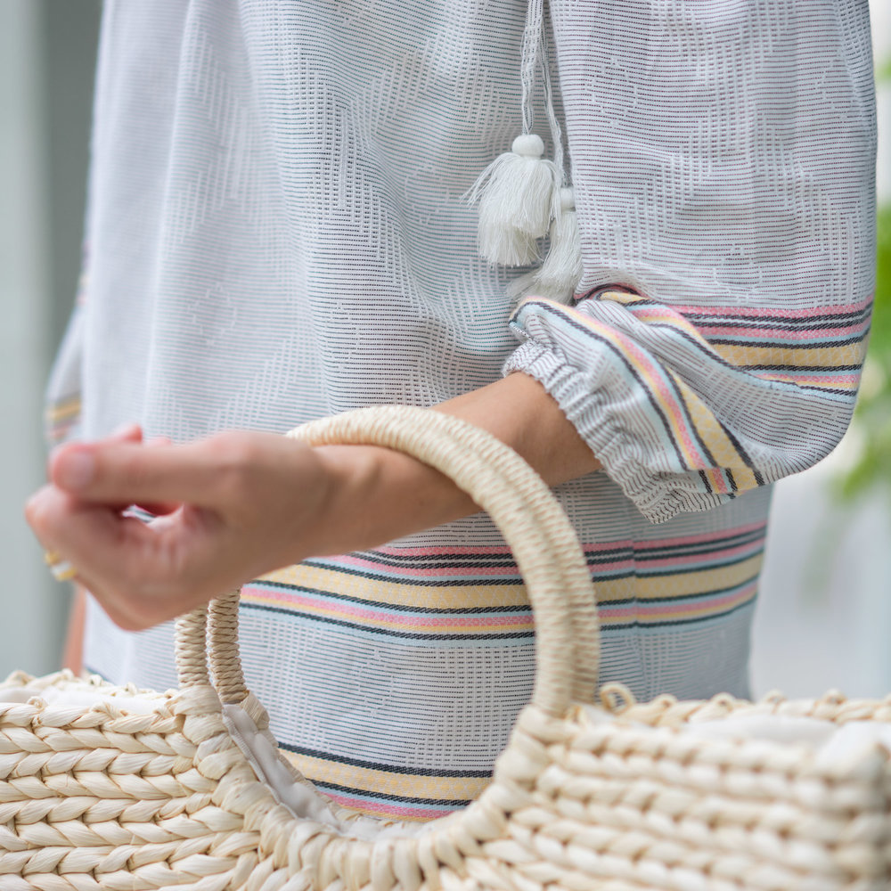 Pastel stripes and straw bag
