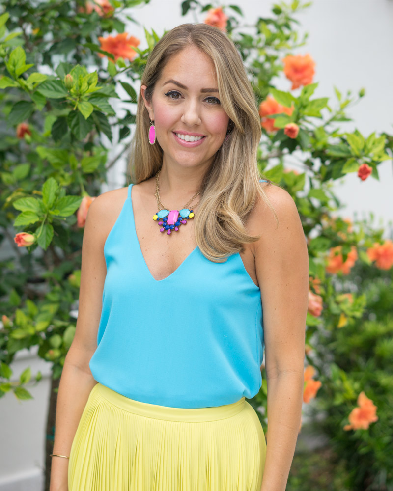 Colorful outfit - yellow skirt, pink earrings