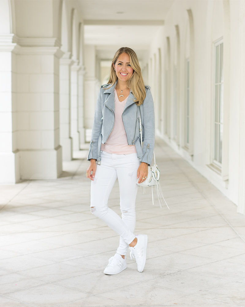 Gray moto jacket, rose Everlane tee, white jeans, sneakers