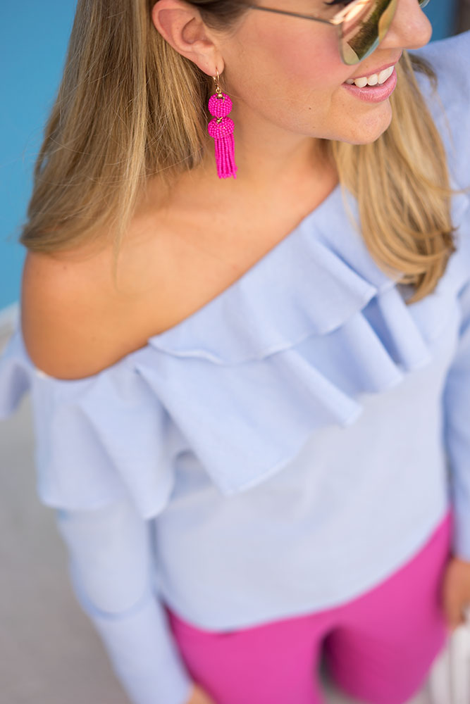 Blue ruffle one shoulder top and pink pants