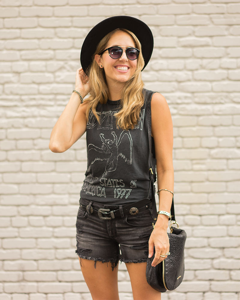Concert tee, western belt, denim shorts