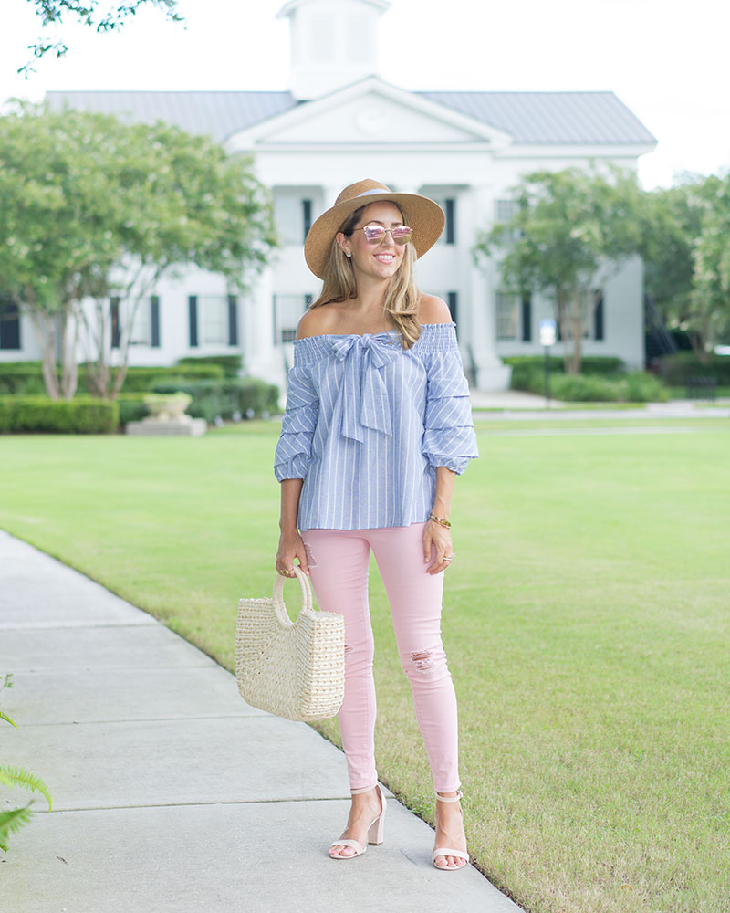 Blue bow top, pink jeans, straw bag and hat