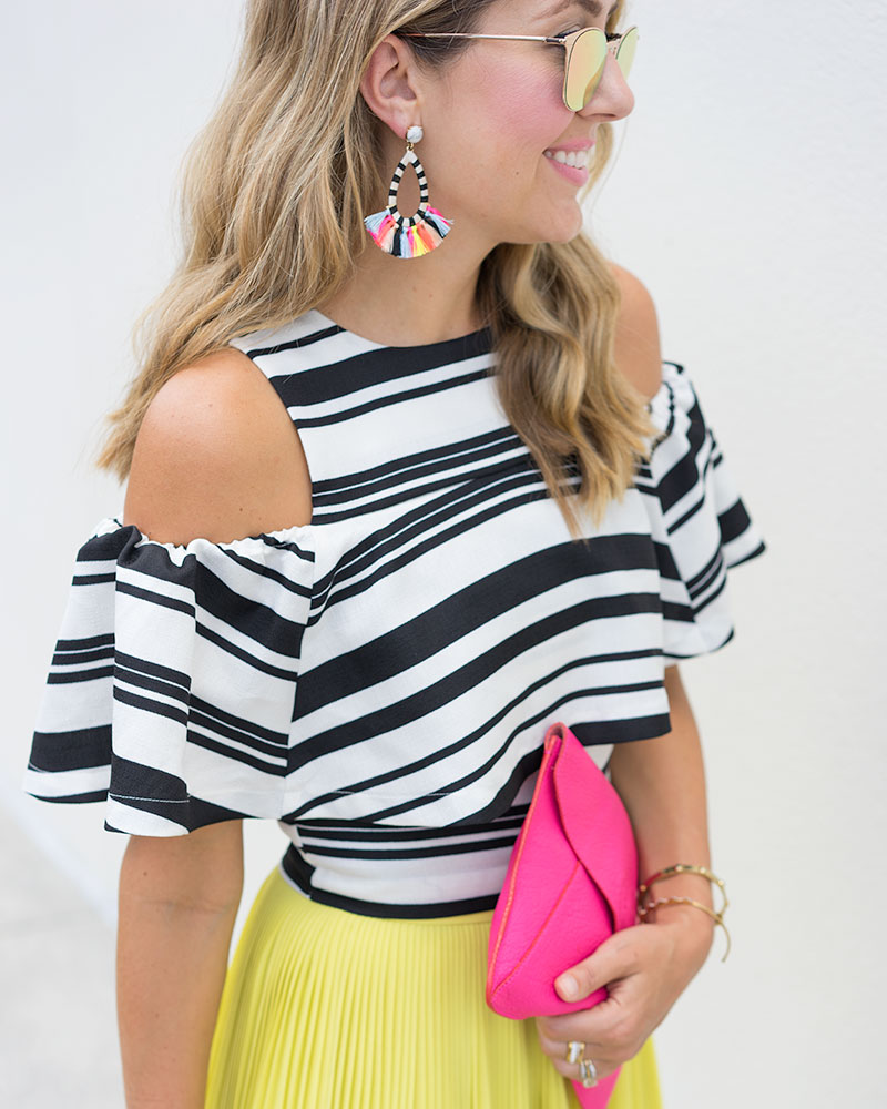 Black and white stripe top, Baublebar Sandbar earrings, yellow skirt, pink purse