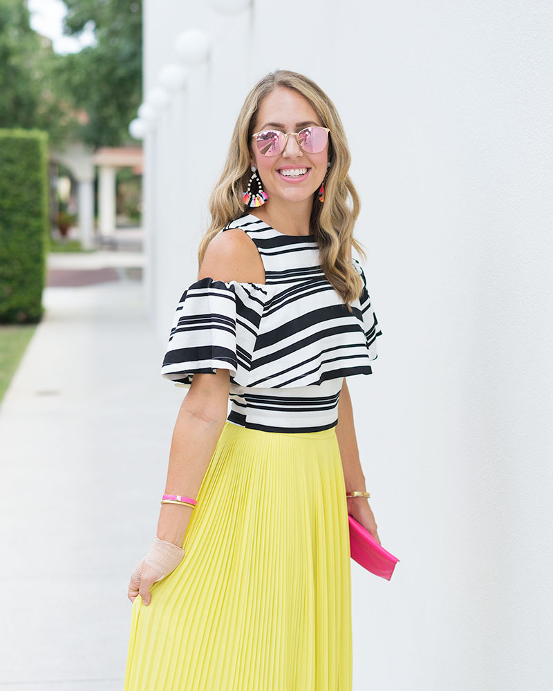 Black and white stripe top, Baublebar Sandbar earrings, yellow skirt