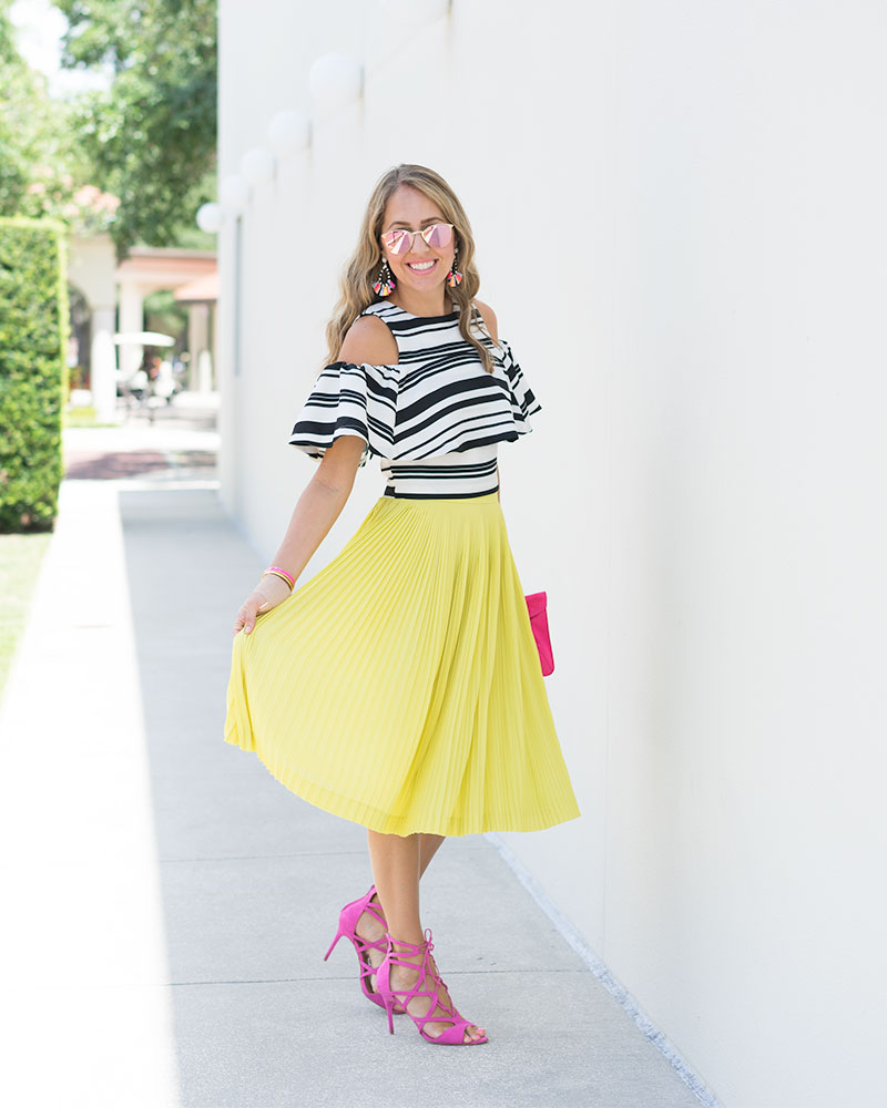 Black and white stripe top, yellow skirt, pink heels