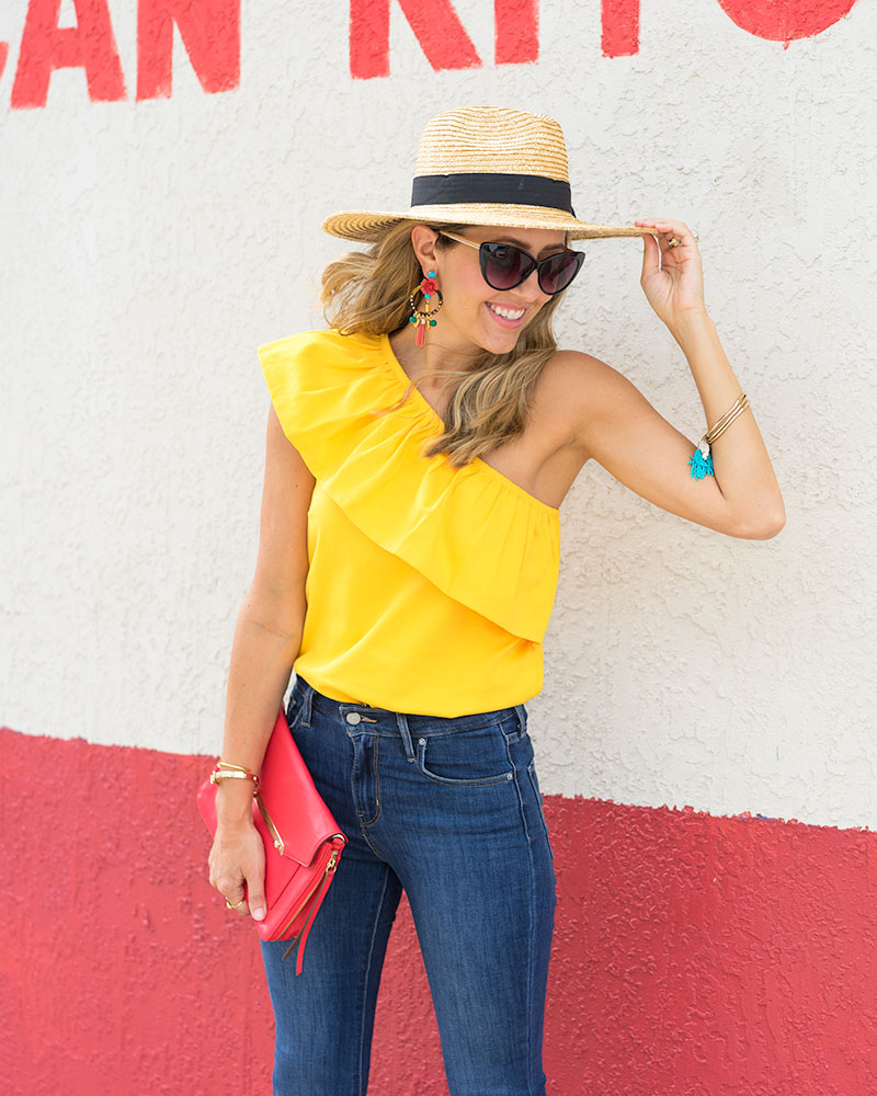 Yellow ruffle top, J.Crew statement earrings, red clutch