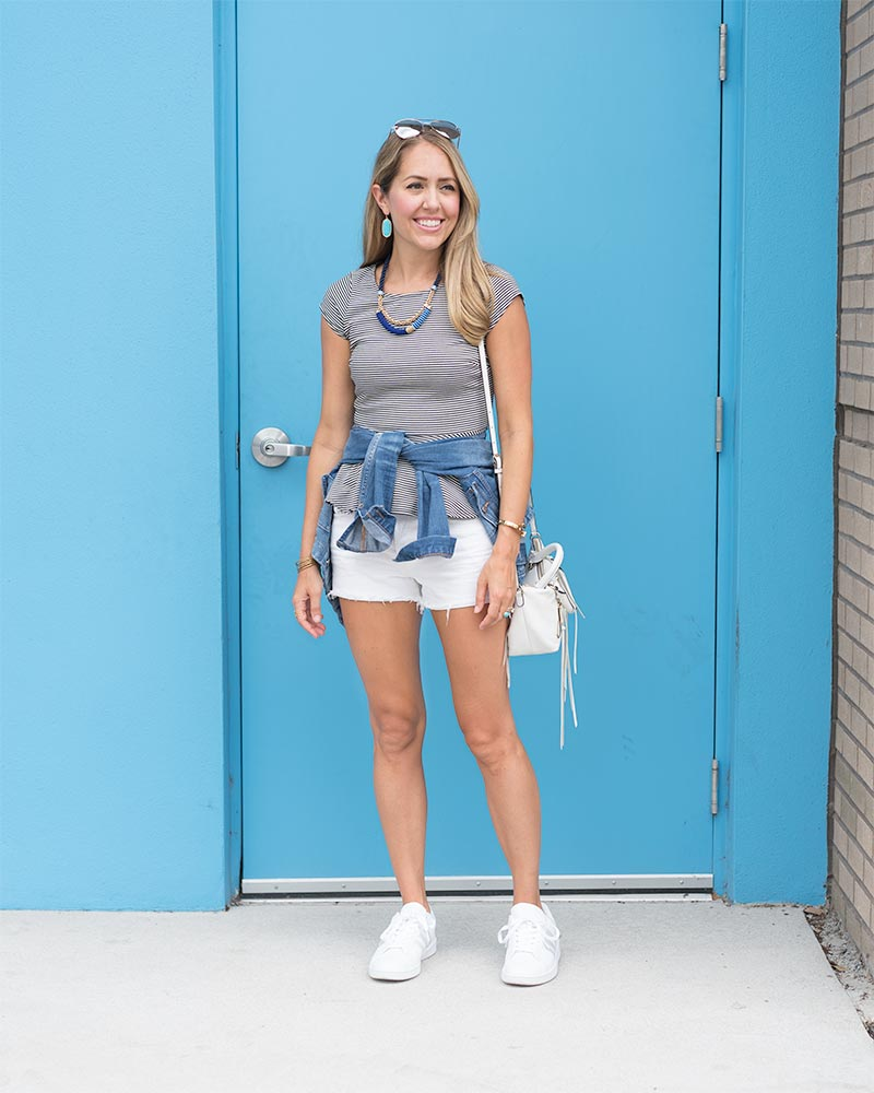 Sneakers outfit: stripe top, cobalt jewelry, white shorts, denim jacket