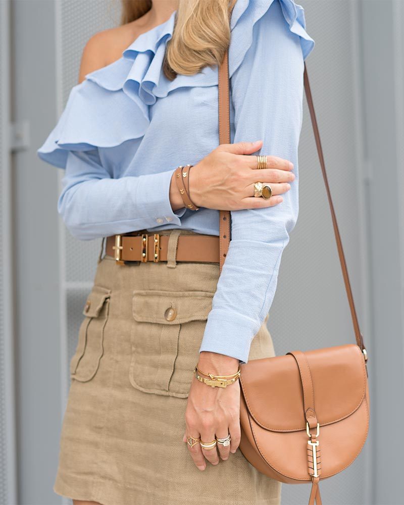 Blue ruffle top, military skirt, cognac purse